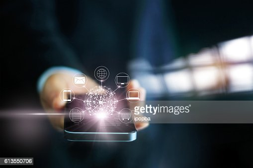 Man using mobile payments, holding circle global and icon customer : Stock Photo