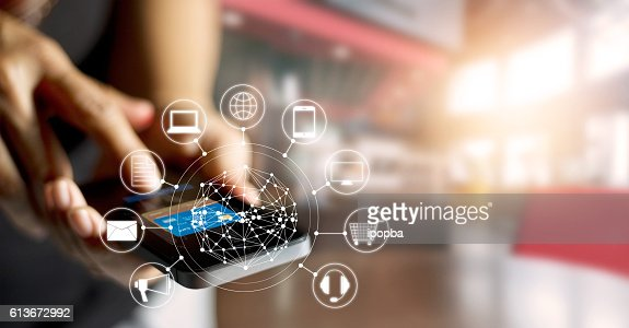 Man using mobile payments online shopping and icon customer network : Stock Photo