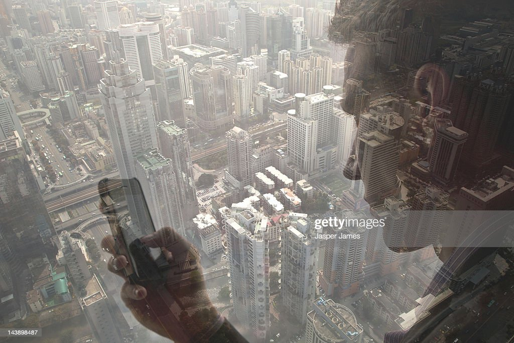 man using mobile phone and cityscape : Stock Photo