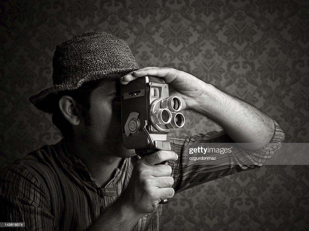 Man using old fashioned cinecamera