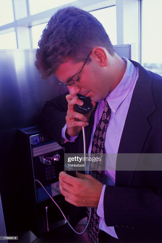 Man using pay phone and pager