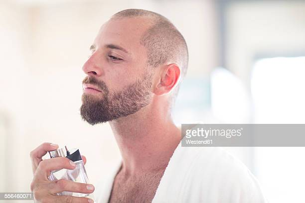 Man using perfume