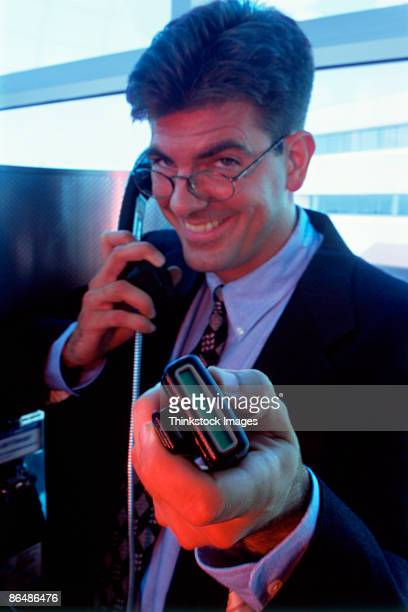 Man using phone and pager