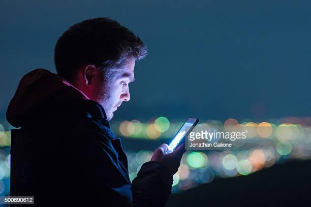 Man using phone at night