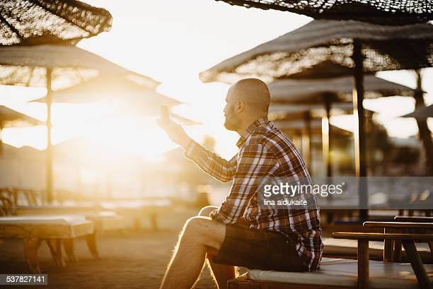 Man using phone on the beach