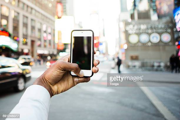 Man using phone to take picture