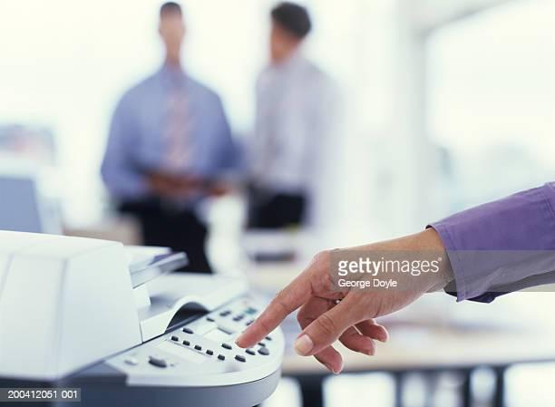 Man using photocopier, close up