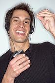 Man Using Portable Music Device