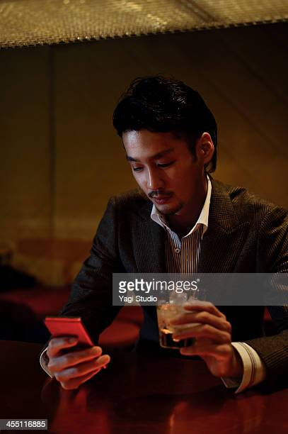 Man using smart phone in the bar