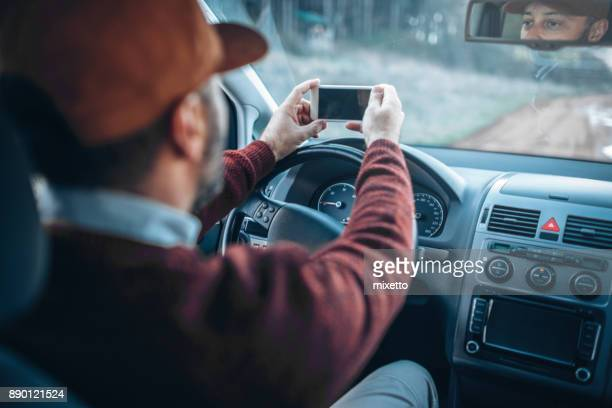 Man using smart phone on the road