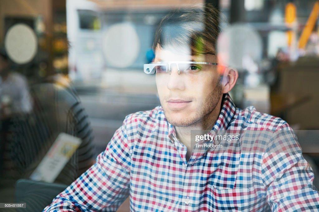 Man using Smart-Glass through window.