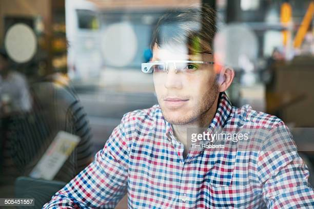 Man using Smart-Glass through window.