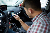 Man using smartphone as gps navigation for a car