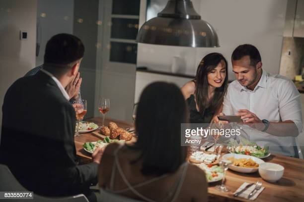 Man using smartphone at the dinner party