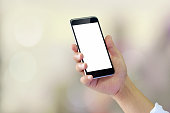 Man using smartphone on blur background. Blank screen smartphone for Graphic display montage.