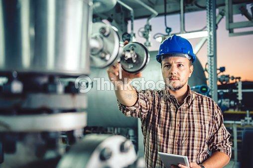 Man using tablet at Natural gas processing facility : Stock Photo