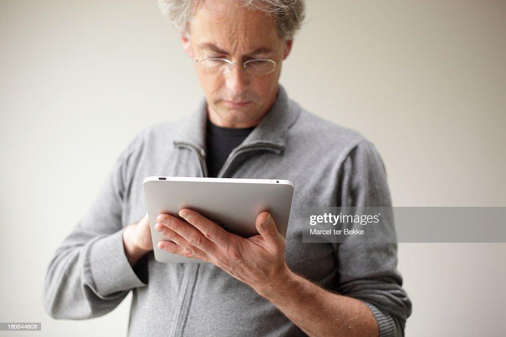Man using tablet computer : Stock Photo
