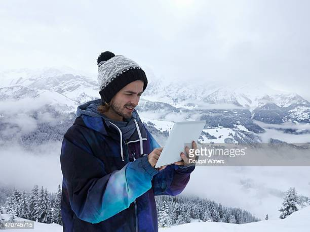 Man using tablet in The Alps.