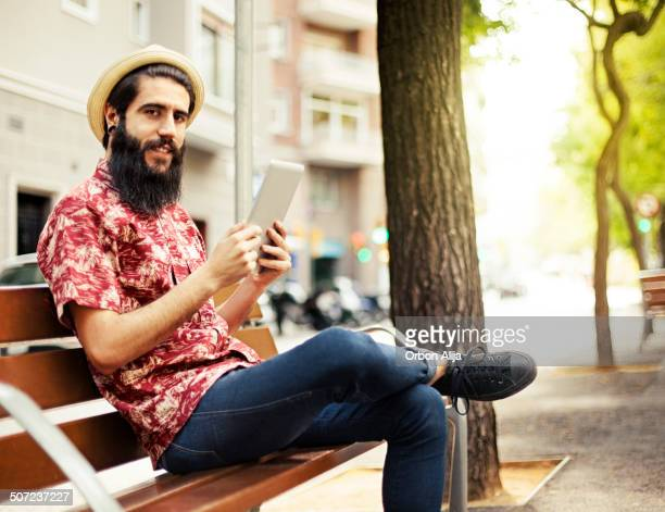 Man using tablet outdoors