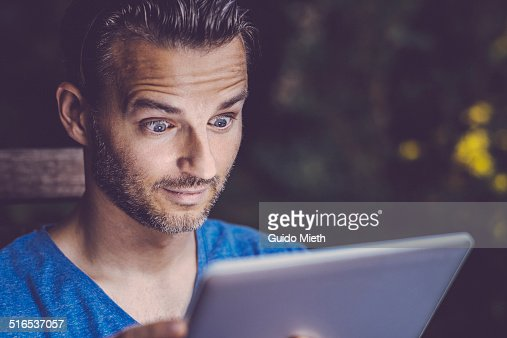 Man using tablet pc outdoor.