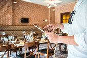 Man using tablet in restaurant