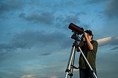 Man using telescope on tripod