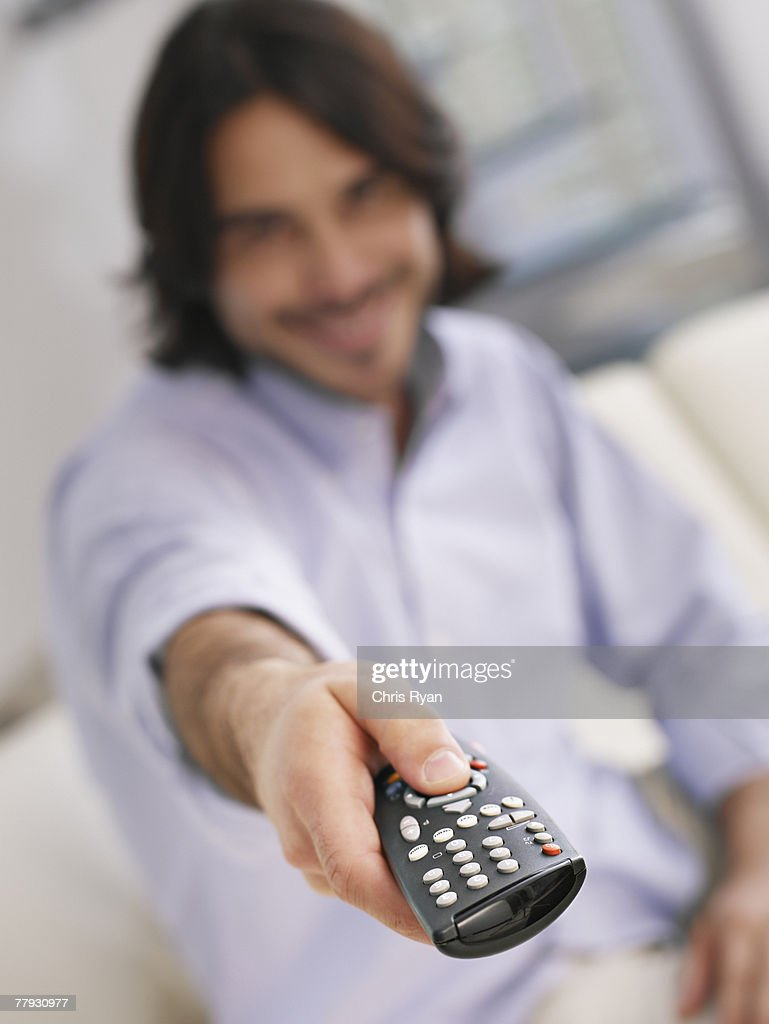 Man using television remote : Stock Photo