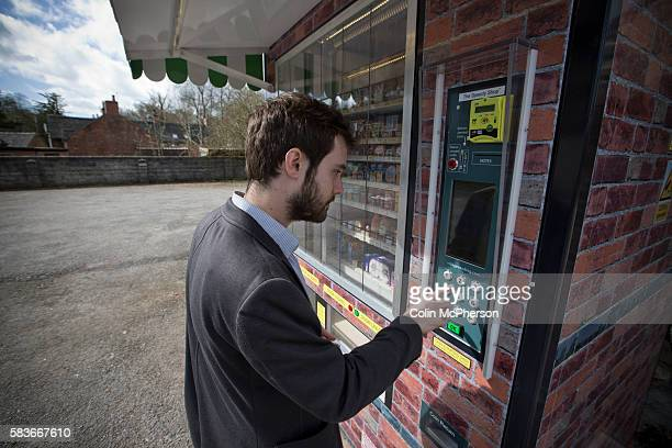 A man using the giant vending machine designed and installed by local businessman Peter Fox in the tiny Derbyshire village of Clifton The fully...