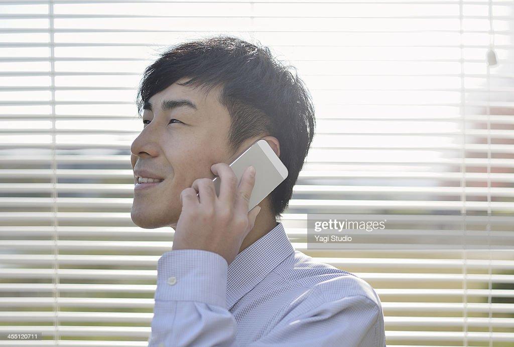 Man using the smartphone : Stock Photo