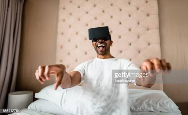man using the virtual reality simulator at home