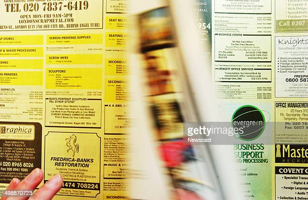 A man using the Yellow Pages telephone Directory