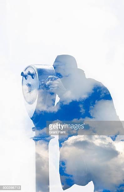 Man using tourist binoculars
