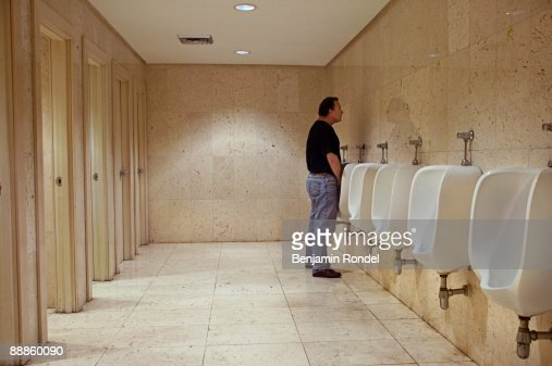 People Peeing Stock Photos and Pictures | Getty Images