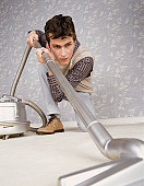 Man Using Vacuum Cleaner