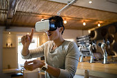 Smiling man using virtual reality headset in restaurant