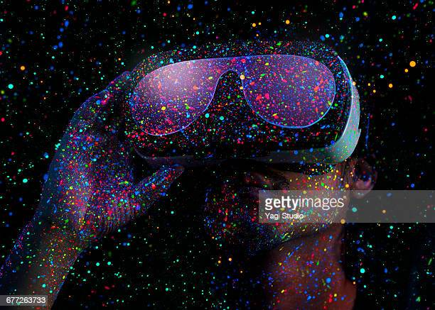 Man using virtual reality headset with Black Light
