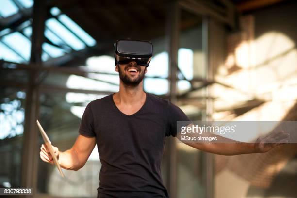Man using virtual reality simulator headset