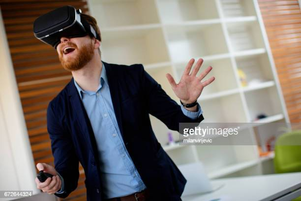 Man using virtual VR headset in the office