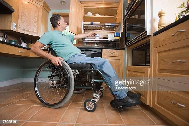 Man using wheelchair in kitchen