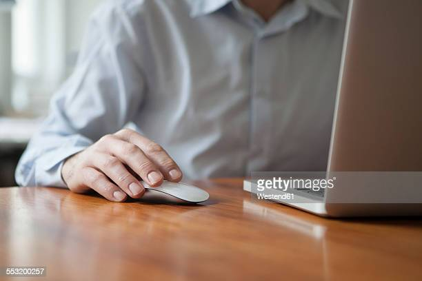 Man using wireless lan mouse