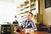 Man using wireless technology in cafe