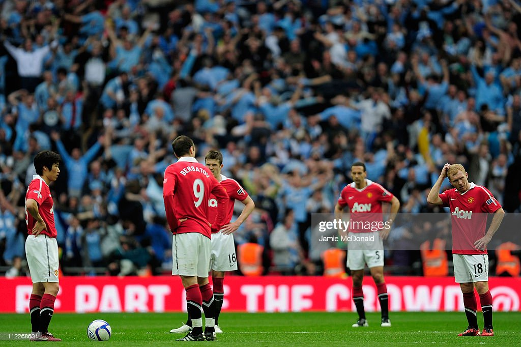 Man Utd players react after Yaya Toure of Manchester City scored the opening goal during the FA Cup sponsored by E.ON semi final match between Manchester City and Manchester United at Wembley Stadium on April 16, 2011 in London, England.