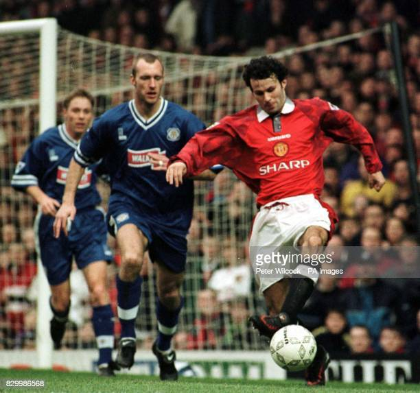 Man Utd's Ryan Giggs battles against Leicester City's Matt Elliott during their match at Old Trafford today The match ended in a 10 win for Leicester...