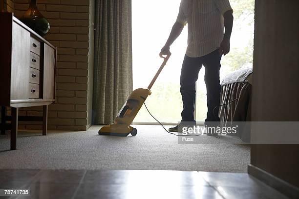 Man Vacuuming Bedroom