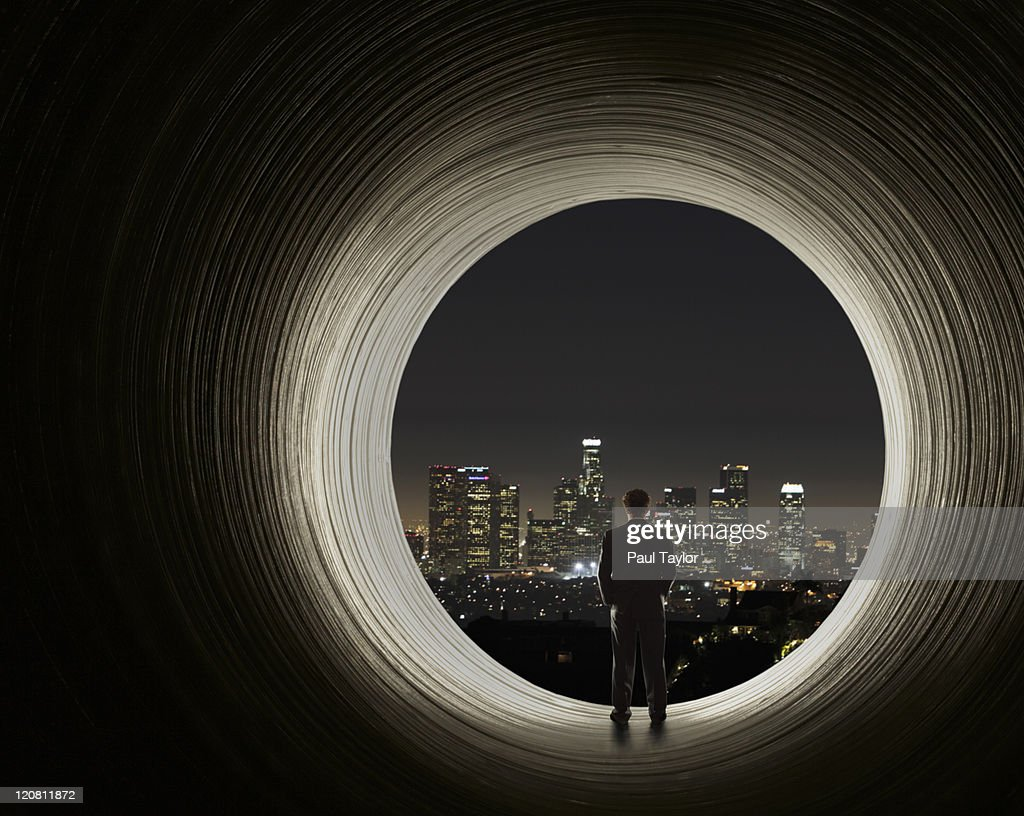Man Viewing City from Tunnel : Stock Photo