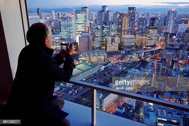 Man viewing the skyscrapers of Umeda Osaka