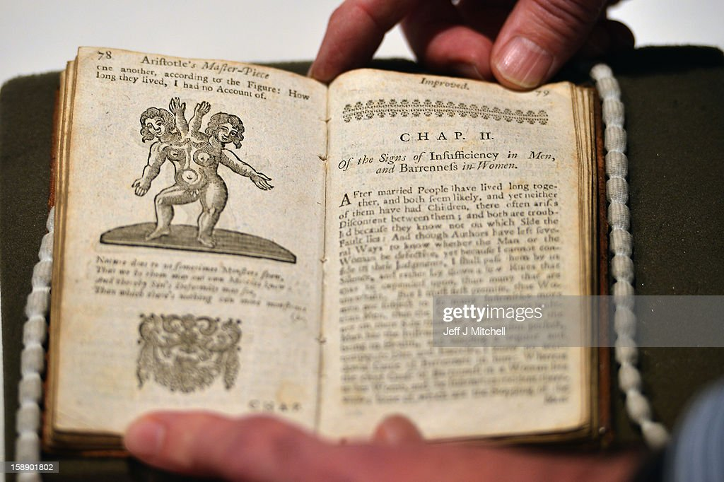 A man views a copy of the once-banned book titled 'Aristotle's Compleat Master-Piece' ahead of its January auction at Lyon & Turnbull on January 3, 2012 in Edinburgh, Scotland. A 1760 edition of the book, which first appeared around 1680 and was banned from sale in the UK until the 1960s, is due for auction at Lyon & Turnbull's book sale on the 9th January 2013 in Edinburgh. Incorrectly attributed to Aristotle, the book is of unknown authorship.