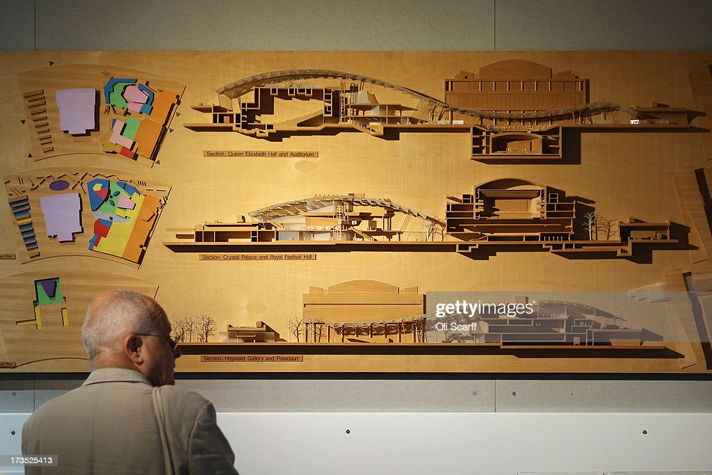 A man views a cross-section model of proposed buildings for London's Southbank in the exhibition 'Richard Rogers
