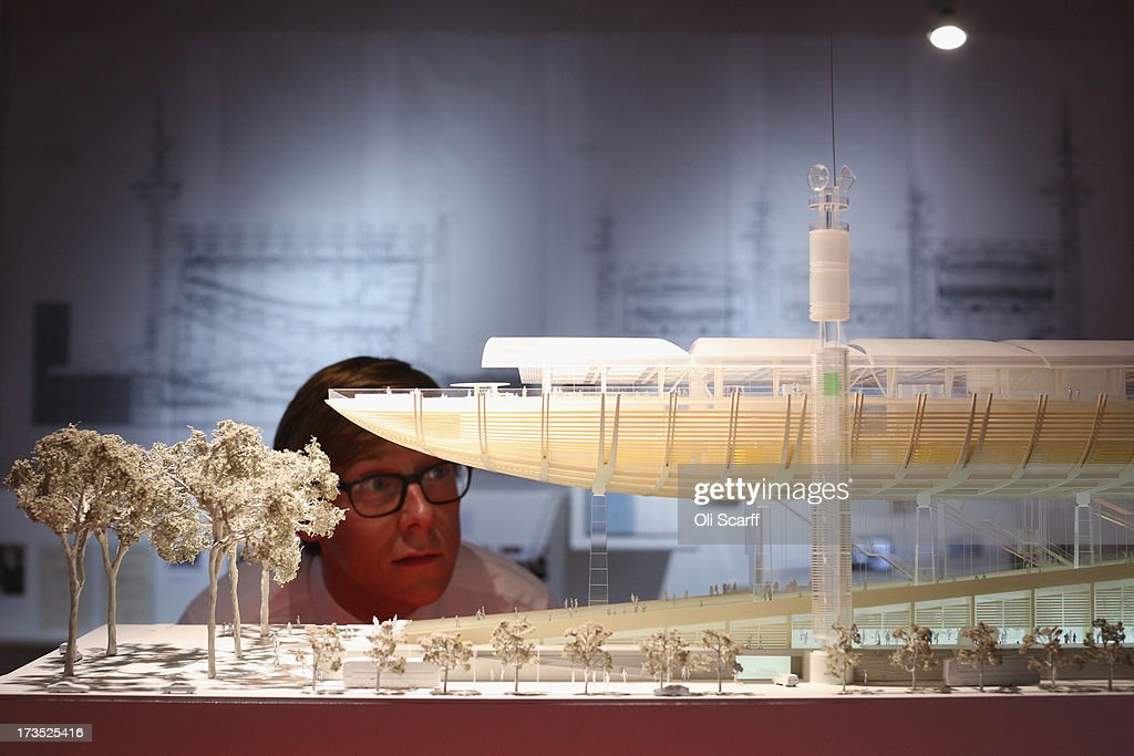 A man views a model of the proposed Rome Congress Centre in the exhibition 'Richard Rogers