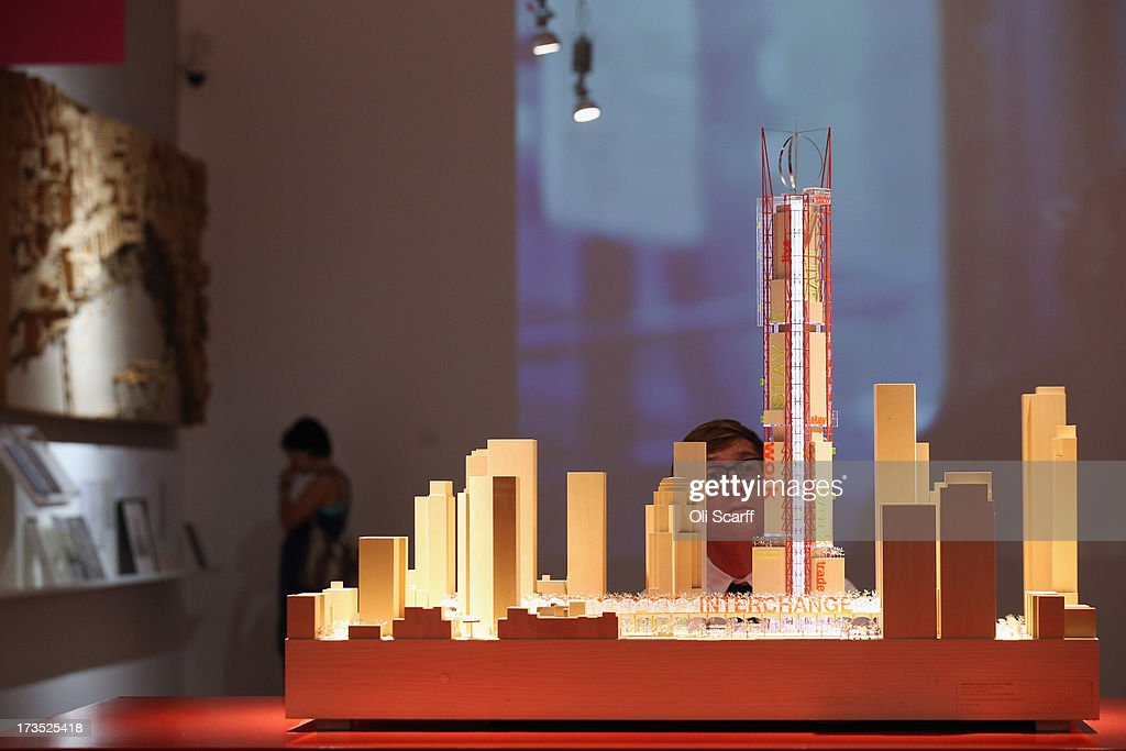 A man views a model of the Transbay Transit Centre and Tower in San Francisco in the exhibition 'Richard Rogers